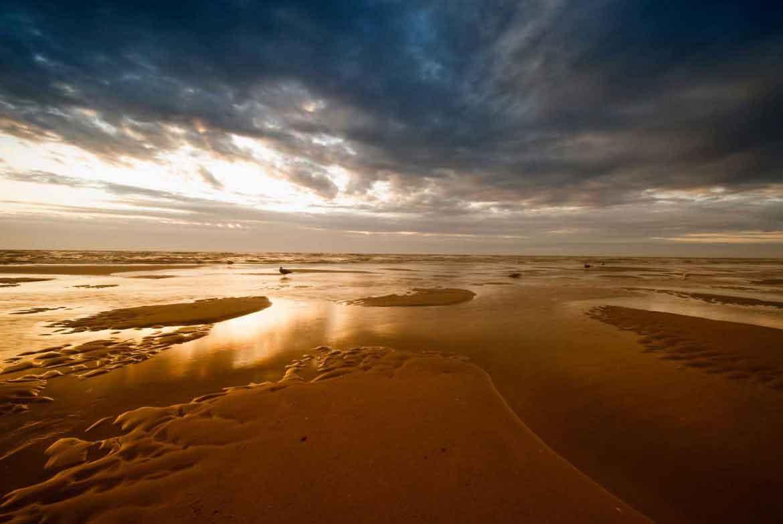 Moody coastal sunset